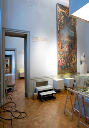 Figure 1 – Solid surface light boxes were installed on the lower wall to accomplish 3 main objectives – illuminate the paintings; offer information about the exhibits via backlit inscriptions; and serve to prevent the public from getting too close to the