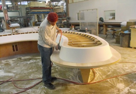 Figure 6 – Creating a set of thermoformed solid surface benches was another aspect to the project. The wooden support structure was used to mold the material.